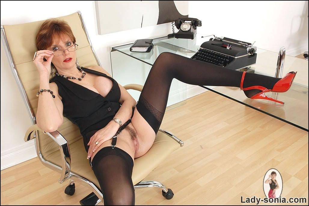 Spread legs mature secretary