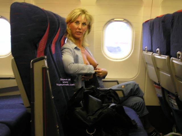 Flashing tits on airplane