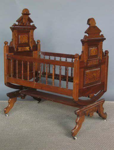 Antique victorian swinging bassinet