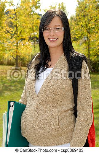 Young brunette teen outdoors