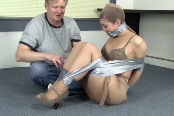 Tape gagged encased in pantyhose