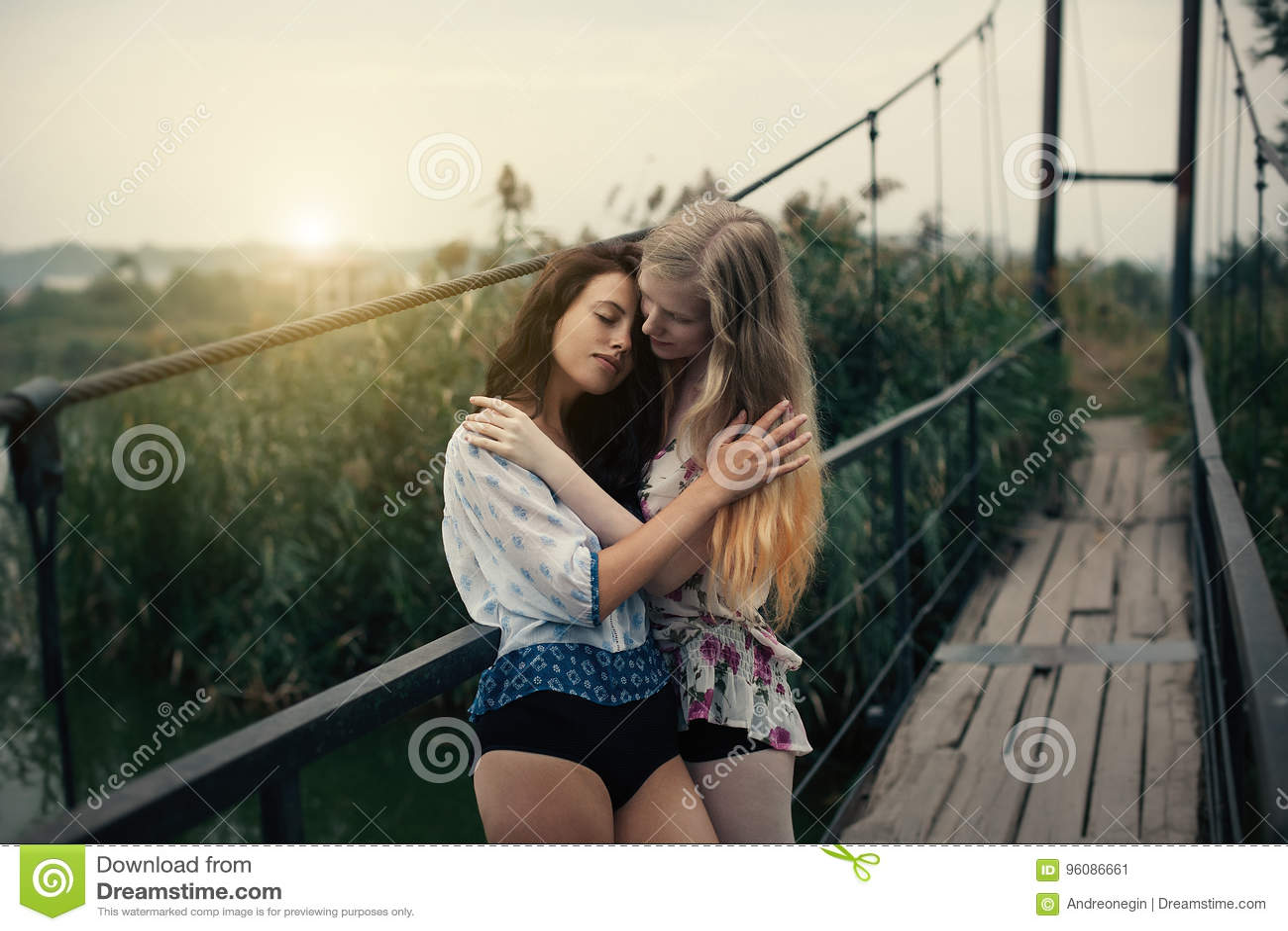 Beautiful blonde and brunette lesbians
