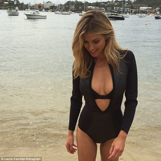 Sexy girl unzipping wetsuit