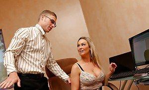Busty teacher gives student a blowjob