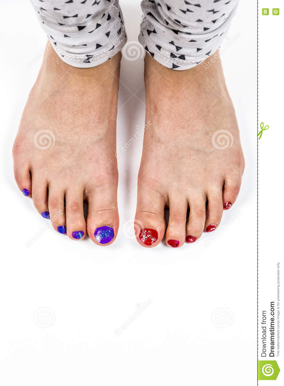 Young feet with painted toenails