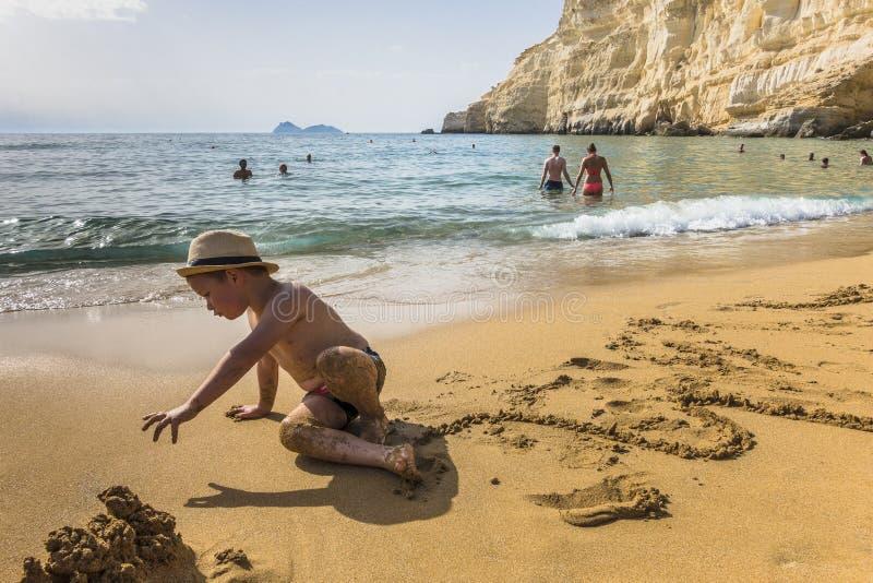 Naked boy on nude beach