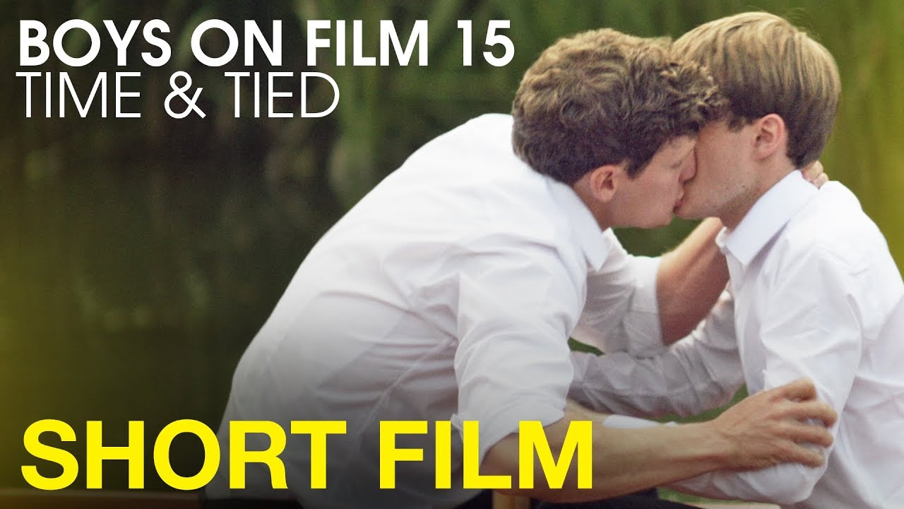 Young teen boys kissing
