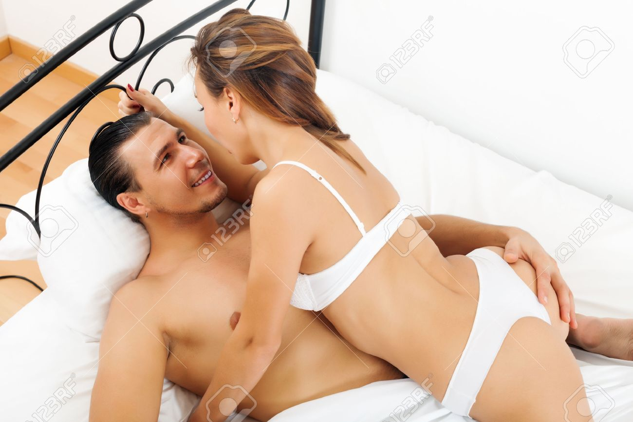 Man and women on bed having sex