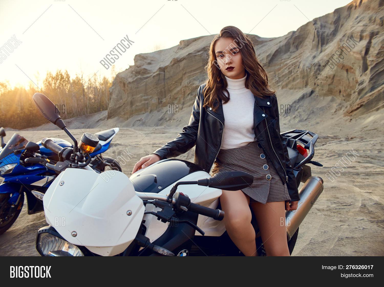 Teen girl on motorcycle