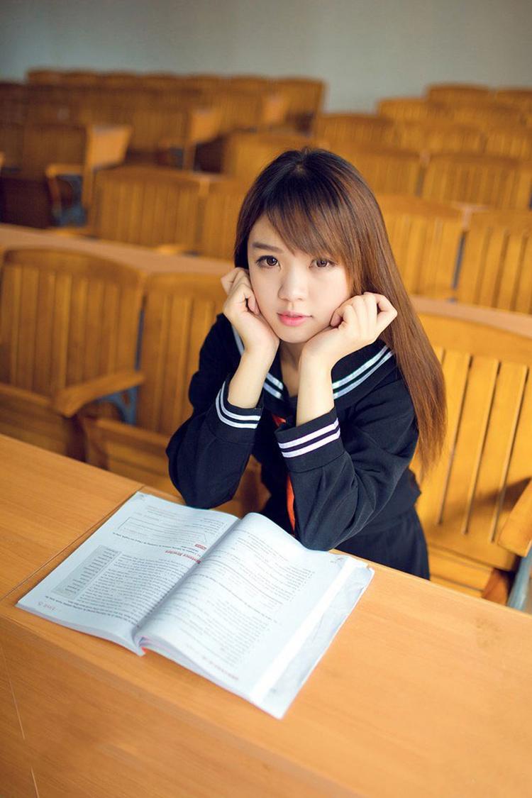 Japanese girls sitting on desk