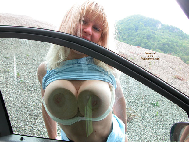 Boobs pressed against glass