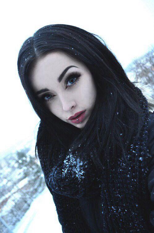 Black hair pale skin girl