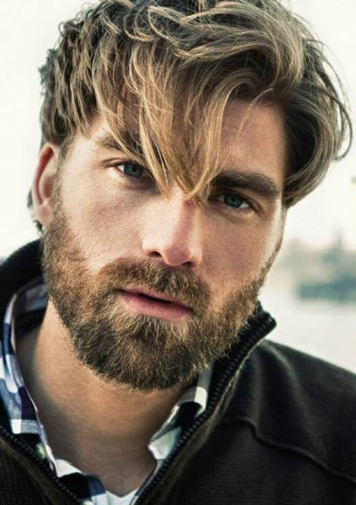 Man with blonde hair and scruffy beard
