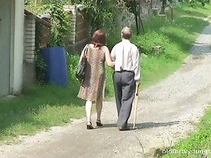 Horny mature couple outdoor