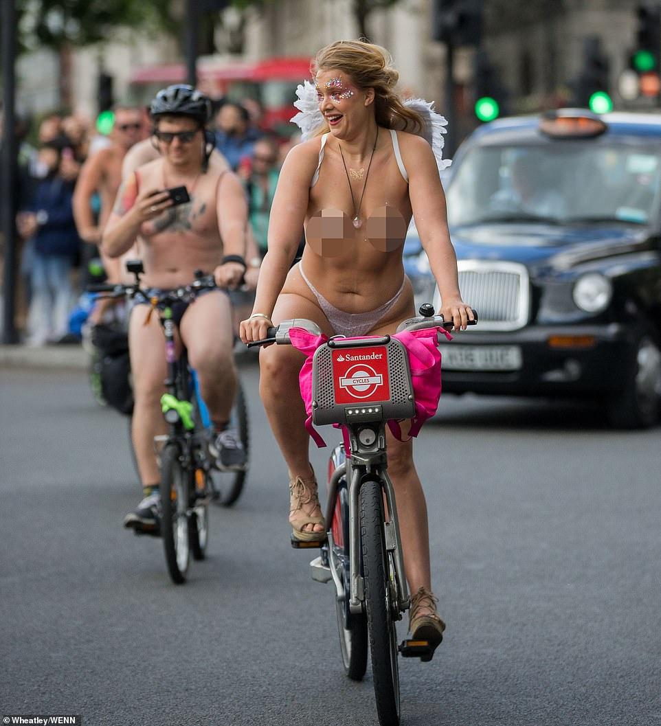 Naked bike ride woman