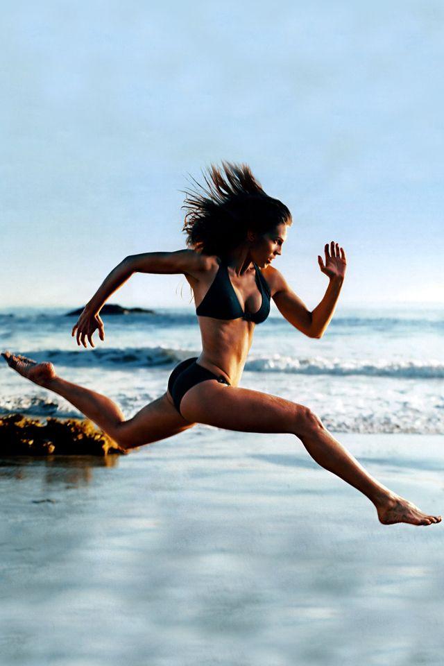 Hilary swank running on beach
