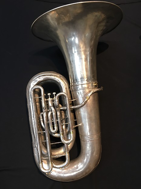 Nude girl playing tuba