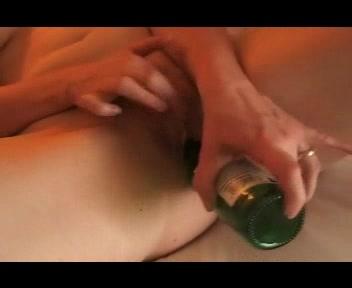 Hot girl masturbating with beer bottle