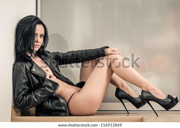 Woman naked wearing high heels