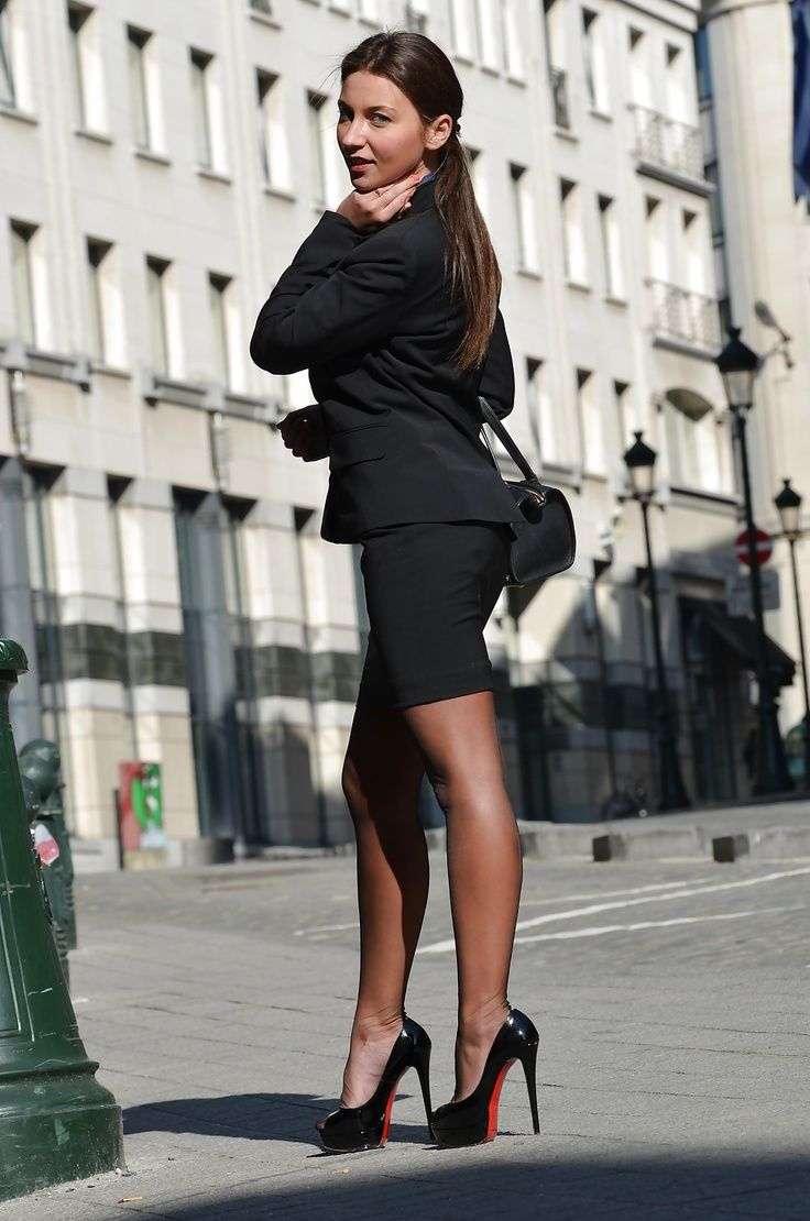 Black skirt suit high heels and stockings