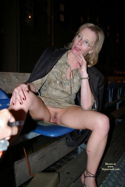 Blonde milf flashing pussy