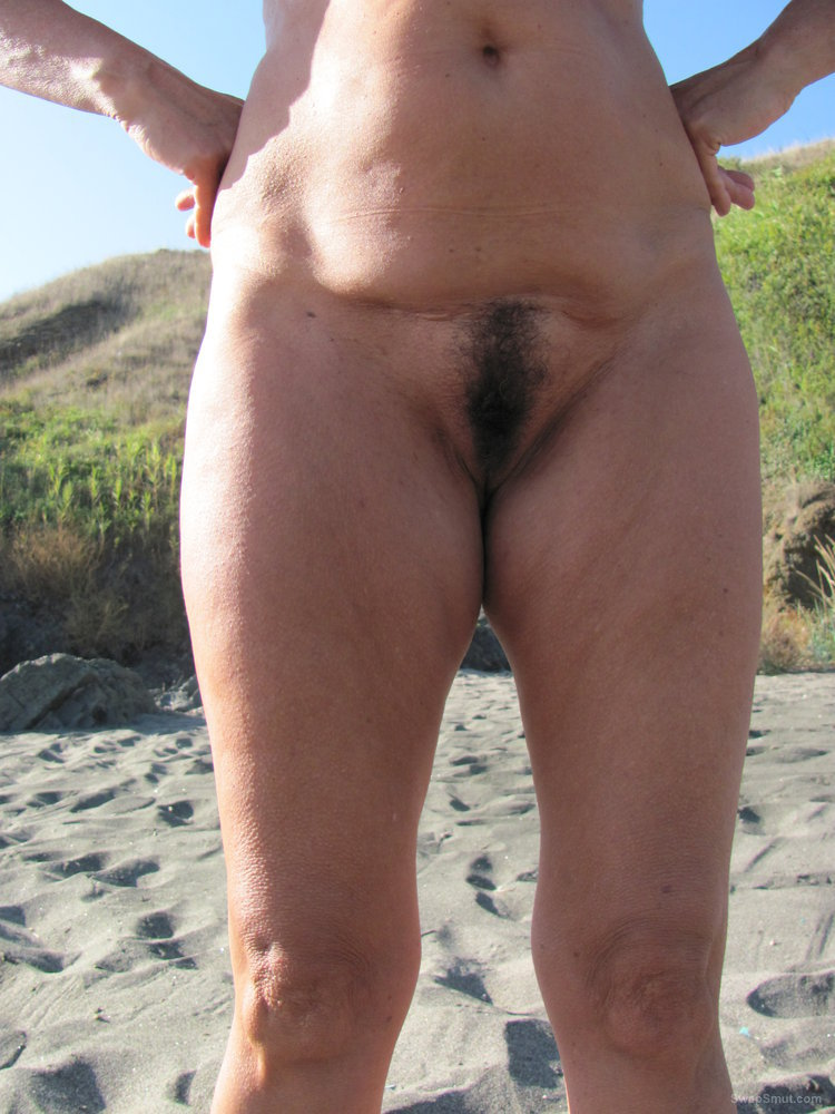 Mature hairy pussy on beach