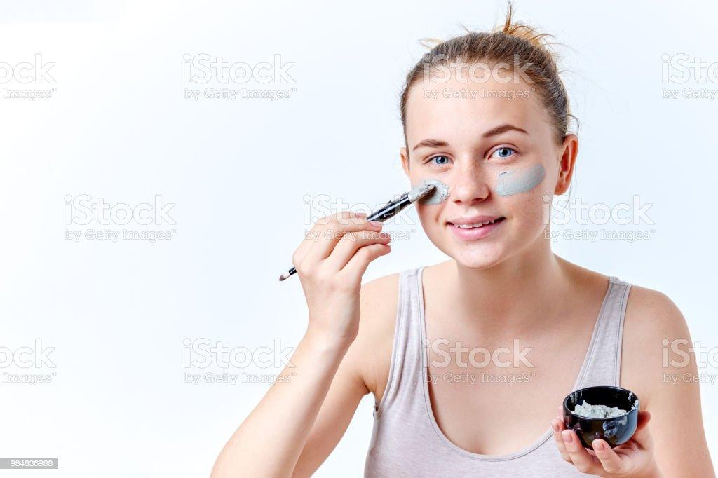 Young teen girl facial