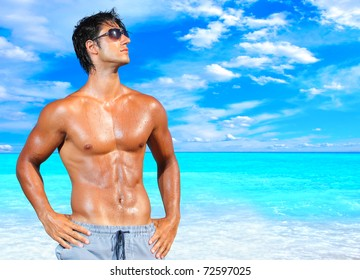 Hot ethnic boys at beach