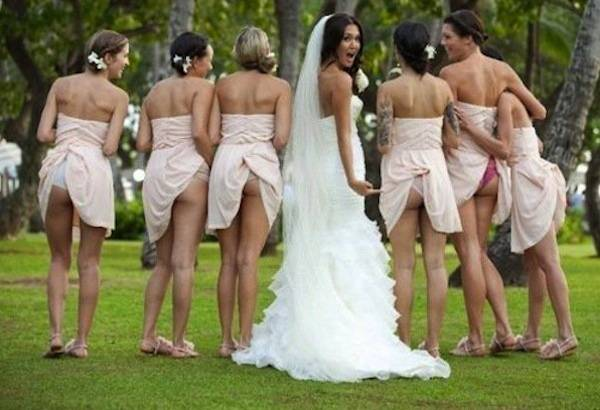Bride and bridesmaid flashing
