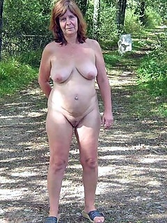 Mature nude in woods