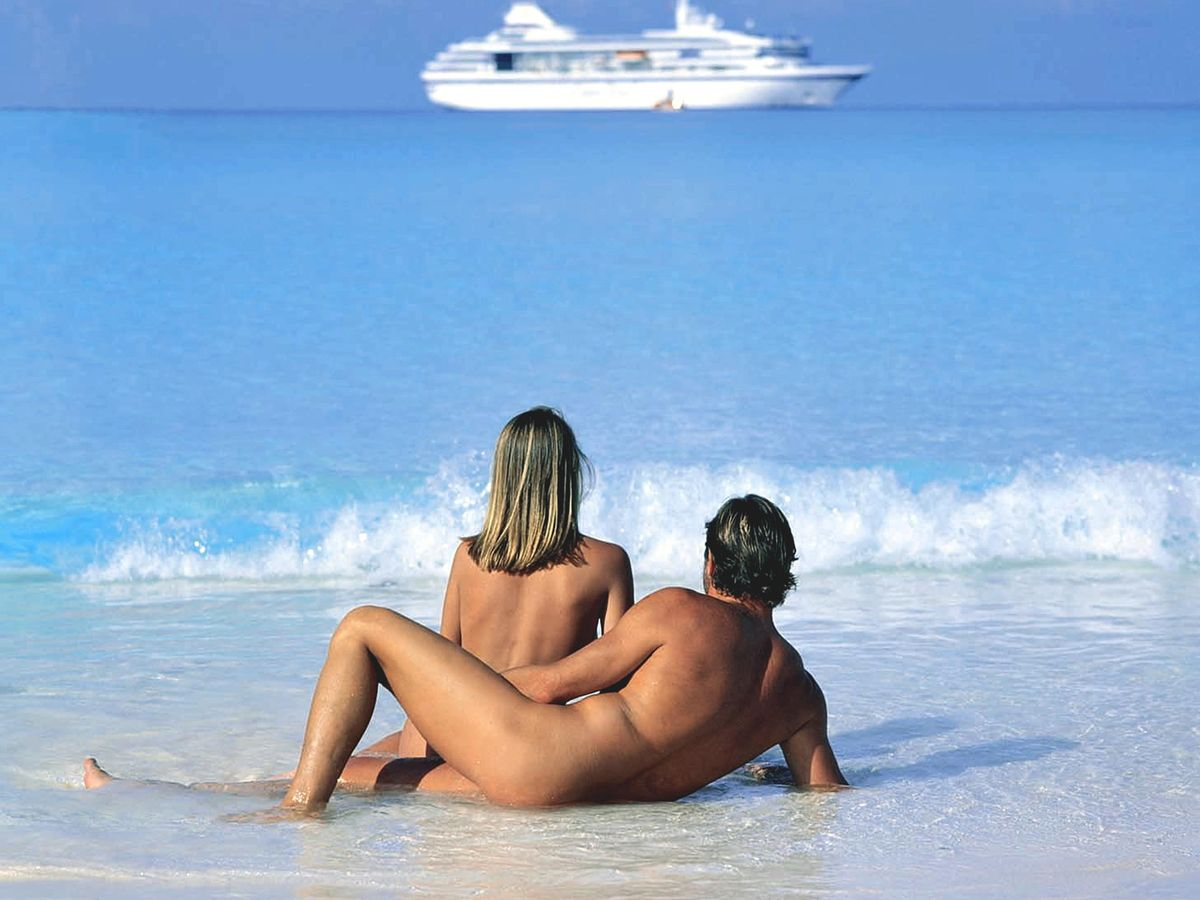 Holding couple with erection nude beach