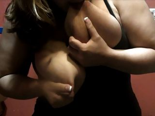 Girls squeezing breast milk out