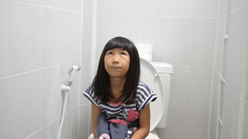 Naked asian girl peeing in toilet
