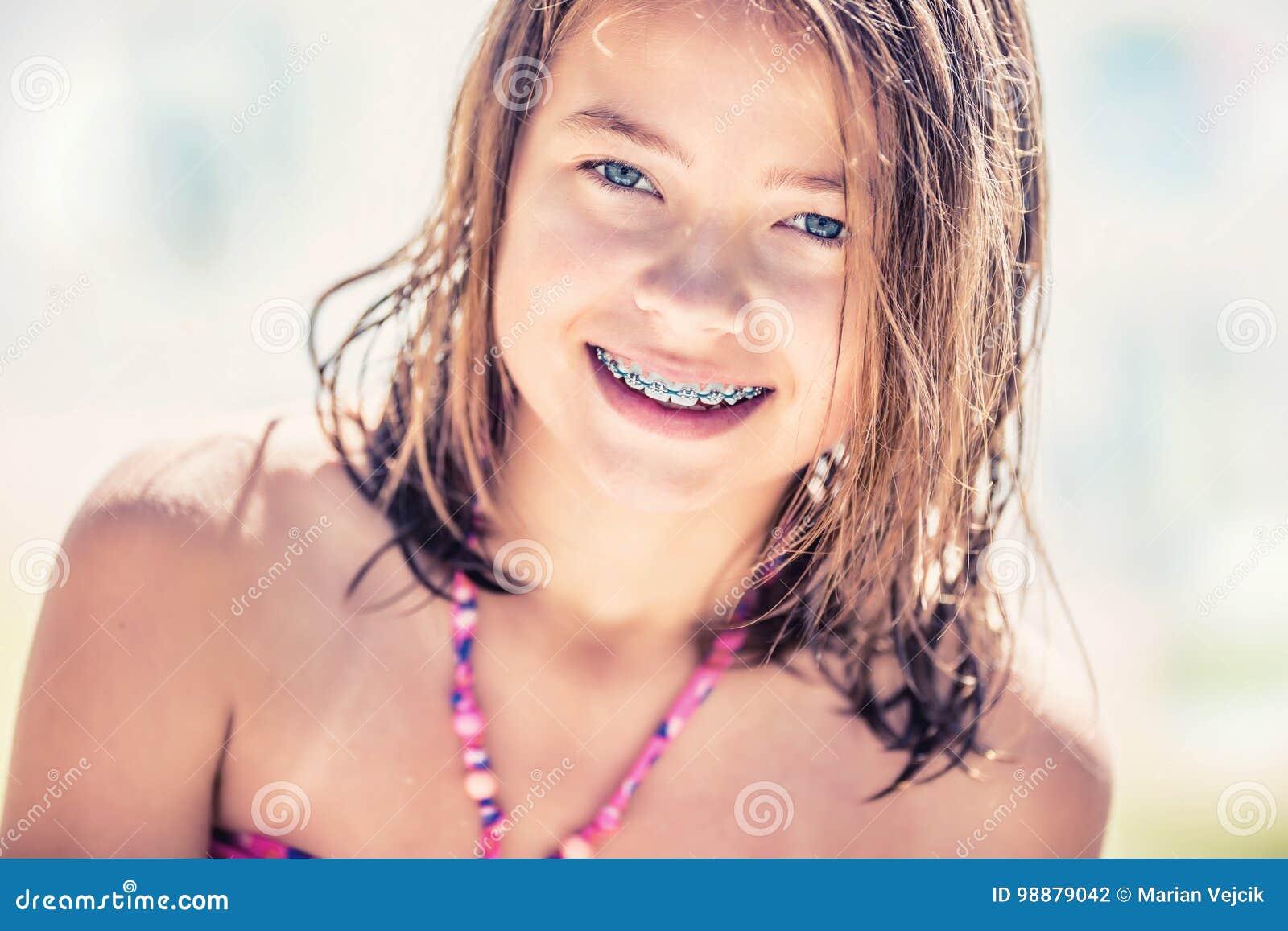 Tiny teen with braces