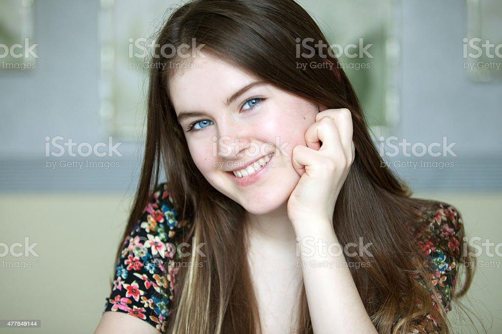 Cute teen girl with blue eyes