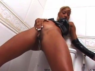 Nude black girl pissing