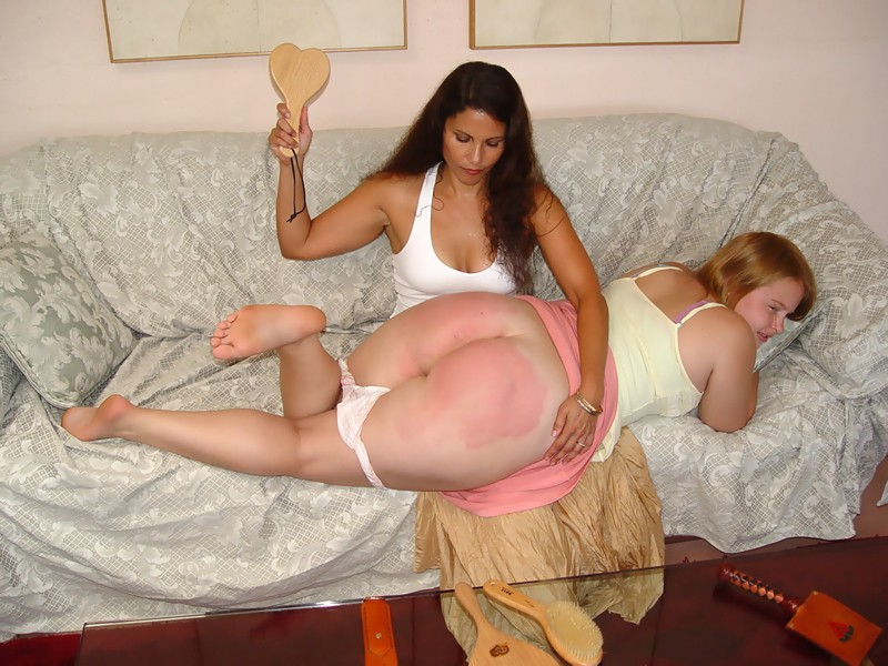 Chubby girl spanked on large ass