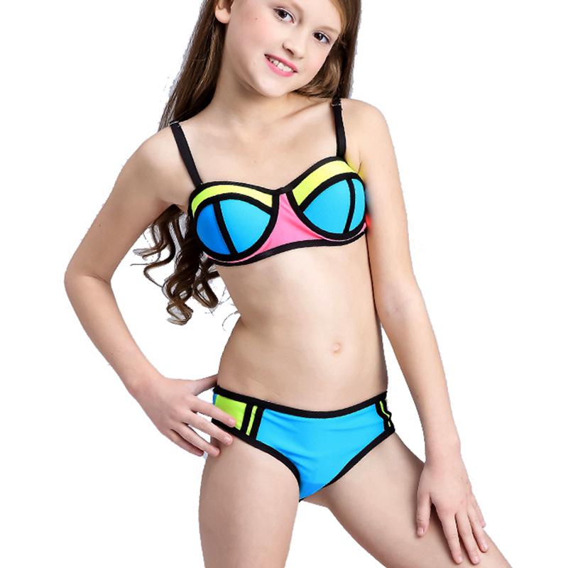 Teen girls posing in bikinis