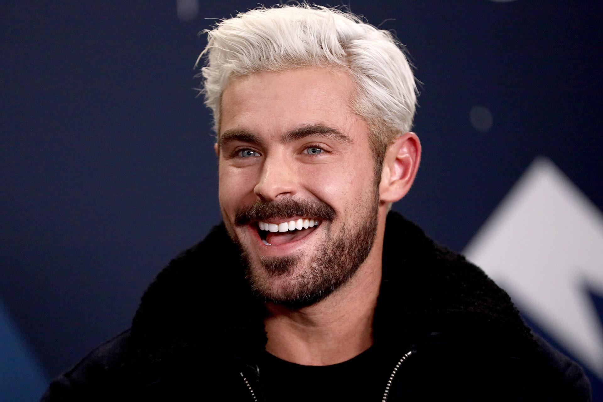 Man with blonde hair and scruffy beard