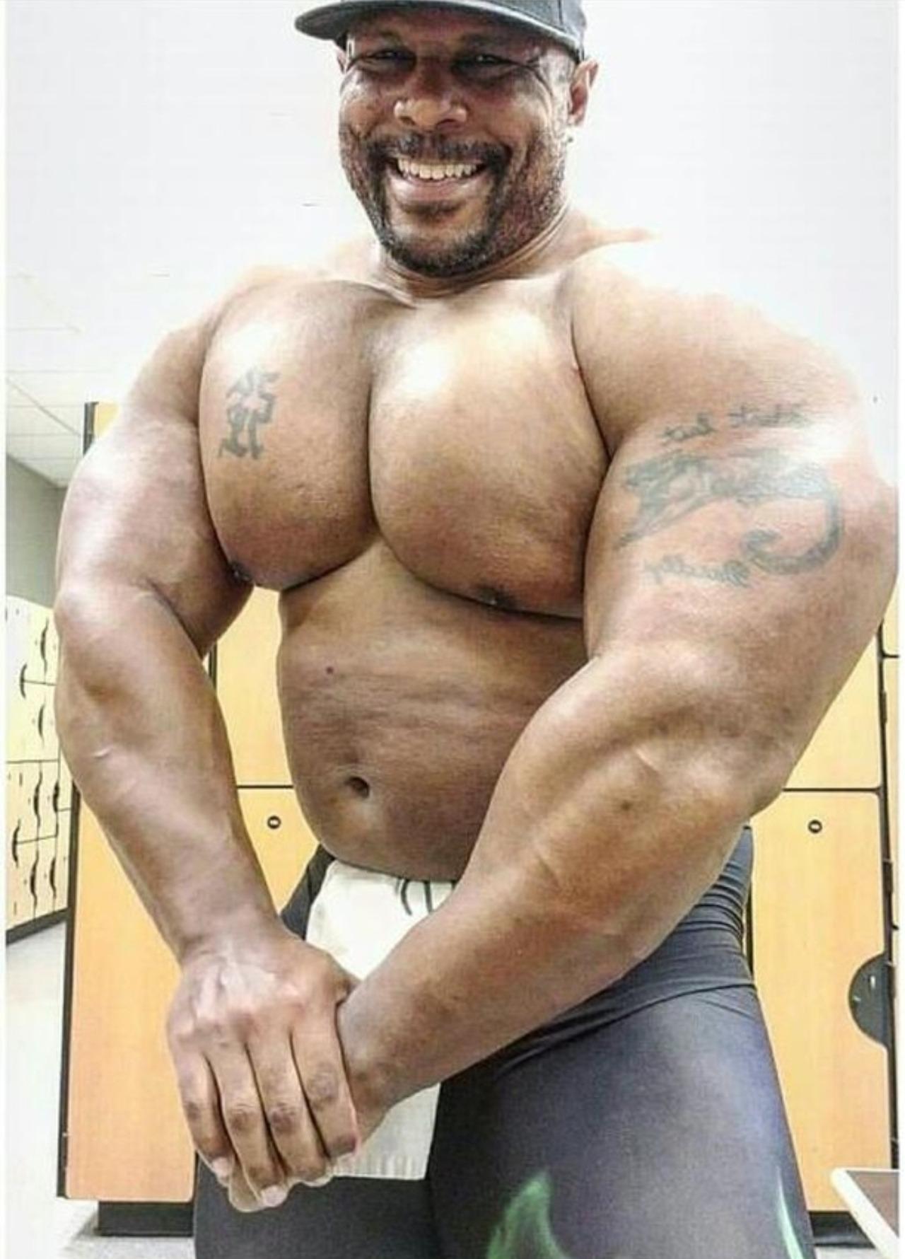 Nude ebony chubby stocky man