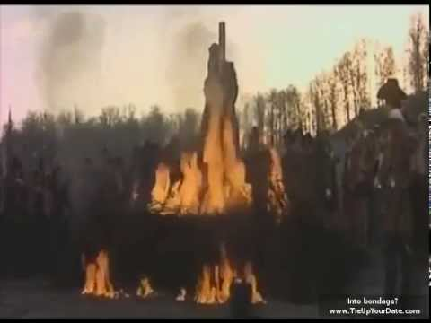 Naked women being burned at the stake