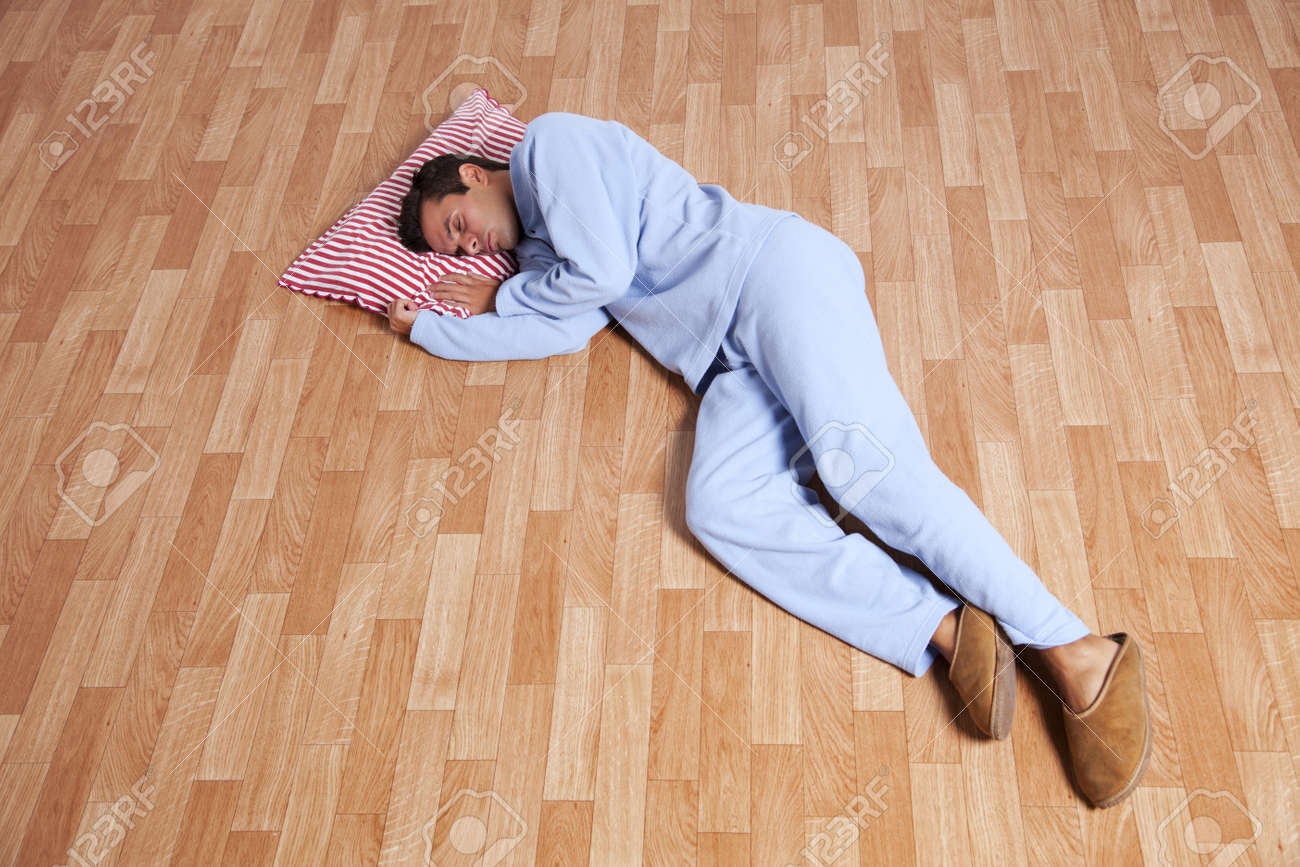 Man sleeping on floor