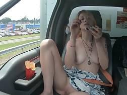 Nude woman masturbating while driving