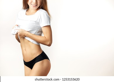 Sexy girl takes shirt off