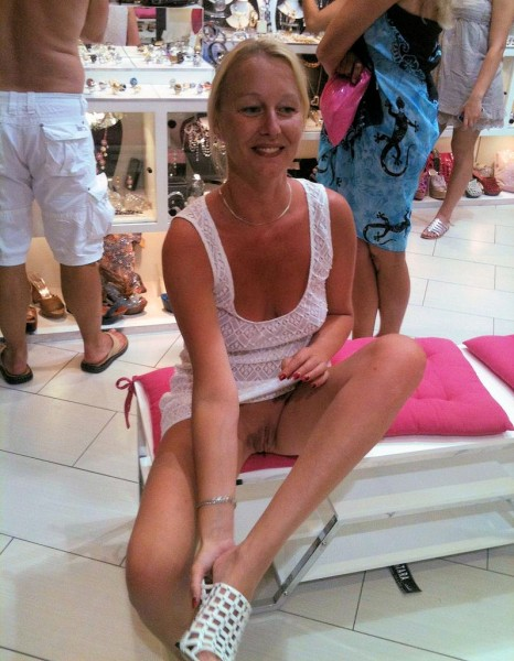 Nude blonde in mall